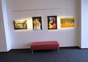 All four of Leah Odero's paintings grouped together at the art exhibit