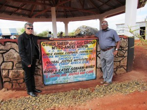 Kenya's Rev Michael Kimindu (right) with MCC Church Elder Rev Pat Bumgardner in front of the new ministry facility in Mtito Andei.