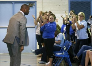 Third grade teacher Omar Currie acknowledges applause in response to his impassioned speech at a community hearing. Photo: Harry Lynch, hlynch@newsobserver.com