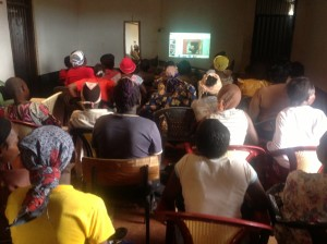 Local Project Ritchie Matua presenting HIV/AIDs prevention training to a crowded room of Mtito Andei people.