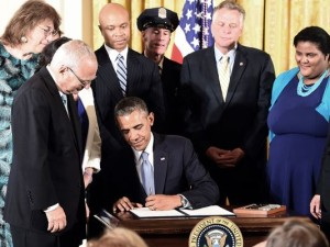 President Obama signing the executive order protecting LGBT Americans working at the Federal Government level.  (photo by Jewel Samad, AFP / Getty Images)