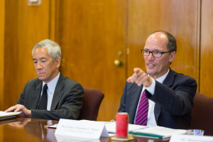 US Labor Secretary Thomas Perez (right) making a point in the meeting coordinated by Center for Faith-Based Partnerships Rev. Phil Tom (left)