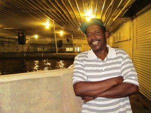 Entrepreneur and Taylor Fish Farm co-founder Valee Taylor standing in front of one of his large tilapia pools