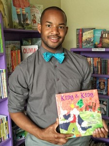 Mr. Omar Currie, holding the book he read to his third grade class, should be a leading candidate for NC Teacher of the Year! (photo washingtonpost.com)