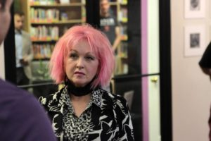 Cyndi Lauper visiting Raleigh's LGBT Center before her June 4th concert.  I recognize the bookshelves in the background!  (Photo courtesy of the Raleigh News and Observer)