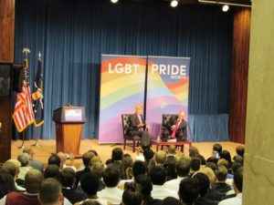 US Senator Tammy Baldwin and US Labor Secretary Thomas Perez on the stage at the US Department of Labor's 2016 LGBT Pride Event.